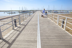 People walking by footbridge at marina, Huelva, Spain Royalty Free Stock Image