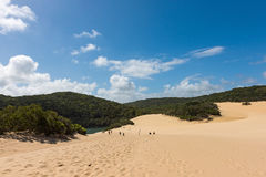 People walking through the Fraser Island sand dunes to get to lake Wabby Stock Photos