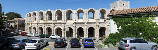 People walking in front of the amphithater at Arles Royalty Free Stock Image