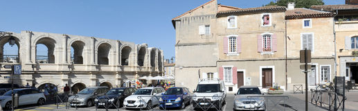 People walking in front of the amphithater at Arles Stock Photo