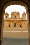 People walking in front of the cathedral at Noto Stock Photo
