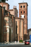 People walking in front of the  church at Asti Stock Image