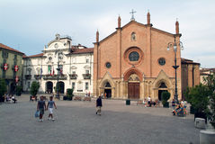 People walking in front of the  church at Asti Royalty Free Stock Image