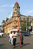 People walking in front of a colonial house of Yangon Royalty Free Stock Images