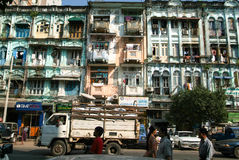 People walking in front of a colonial houses of Yangon on Myanma Stock Images