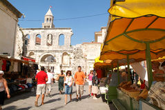 People walking in front of Diocletian palace in Split Royalty Free Stock Photography