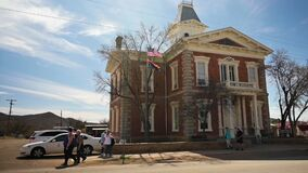 People walking in front of the historic Cochise county courthouse at Tombstone State Park In Arizona