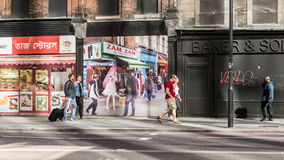 People walking in front of local shops in Bishopsgate, Shoreditch, East London, Royalty Free Stock Photography