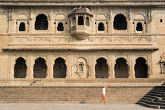 People walking in front of Maheshwar palace on India Stock Photos