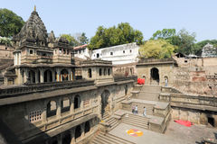 People walking in front of Maheshwar palace on India Stock Images