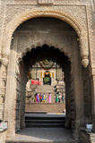 People walking in front of Maheshwar palace on India Stock Photo