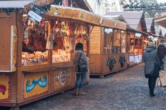 People walking in front of  pain of spices stand at the christmas market Stock Photos