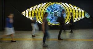 People walking in front of the Shinjuku Eye. Tokyo, Japan - 27th June 2016: People walking in front of the Shinjuku or Tokyo Eye, a glass sculpture at Shinjuku stock photos