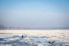 People walking on the frozen Danube in Belgrade, Serbia, in January 2017 due to an exceptionally cold weather over the Balkans. A period of exceptionally cold Royalty Free Stock Image