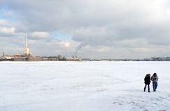People walking on frozen Neva river Stock Image