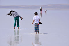 People walking on the frozen salt, in Turkey Royalty Free Stock Photo