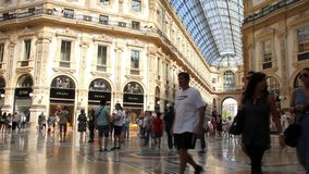 People walking in the Galleria Vittorio Emanuele II, Milan. The shopping mall, in the center of Milan, is one of the oldest and most famous in the world stock footage