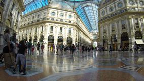 People walking in the Galleria Vittorio Emanuele II, Milan. The shopping mall, in the center of Milan, is one of the oldest and most famous in the world stock video