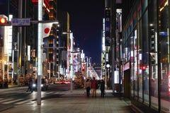 People walking on Ginza street at night in Tokyo, Japan Royalty Free Stock Image