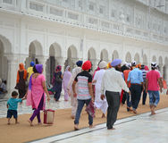 People walking at Golden Temple in Amritsar, India. Amritsar (also called Ambarsar) is a city in the northwestern Indian state of Punjab, not far from the royalty free stock photography