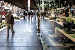 People walking on Gran Via street and reflected in the shopwindow of the old shoe shop La Cordobesa Royalty Free Stock Images