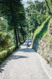 People walking the Greenway Lake Como trail near Lenno, Italy. People walking the Greenway route near Lenno, Italy. Greenway Lake Como is a landscape trail of stock photos