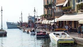 People walking harbour Lazise Garda Lake stock footage