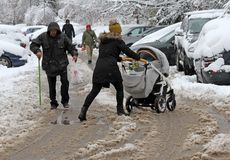 People are walking hard on a snowy icy road after a heavy snowfall in the city of Sofia, Bulgaria on Nov 28,2017, person with cane Stock Photography