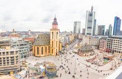 People walking in the Hauptwache plaza in Frankfurt Royalty Free Stock Photo