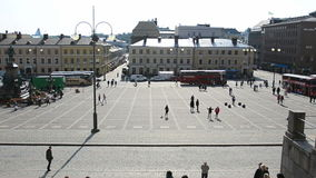 People walking in the Helsinki Senate Square stock footage