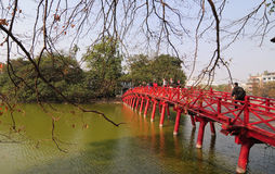 People walking on The Huc bridge in Hanoi, Vietnam Royalty Free Stock Image