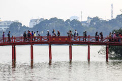 People walking on the Huc Bridge over the Hoan Kiem Lake Royalty Free Stock Images