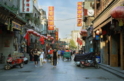 People walking in a hutong near Tiananmen square Royalty Free Stock Photo
