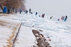 People walking and ice skating on the frozen Balaton Lake Royalty Free Stock Image