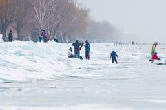 People walking and ice skating on the frozen Balaton Lake Stock Image