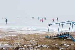 People walking and ice skating on the frozen Balaton Lake Royalty Free Stock Photography