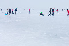People walking and ice skating on the frozen Balaton Lake Stock Photography
