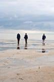 People Walking In Tidal Flat Royalty Free Stock Image