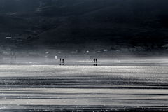 People walking on Inch strand Stock Images