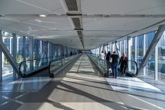 People walking inside Dubai Mall the shopping mall tunnel. DUBAI, UAE - JAN 23, 2016: People walking inside Dubai Mall the shopping mall tunnel.It is the world' Stock Photo