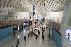 People walking inside the Shenzhen Bao'an International Airport in Guandong, China Stock Images