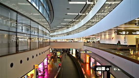 People Walking Inside The Terminal Of Vienna International Airport. VIENNA, AUSTRIA - AUGUST 12, 2015: People Walking Inside The Terminal Of Vienna International stock video footage