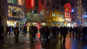 People walking on Istiklal Street at night in Istanbul Turkey. Fast forwarded. Istanbul, Turkey - January 10, 2015: People walking on Istiklal Street at night stock video