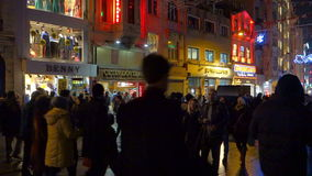 People walking on Istiklal Street at night in Istanbul Turkey. Istanbul, Turkey - January 10, 2015: People walking on Istiklal Street at night. Istiklal Street stock footage