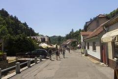 People walking through the Karlštejn village Stock Photos