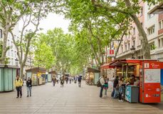 People walking in La Rambla street of Barcelona Stock Images