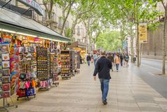 People walking in La Rambla street of Barcelona Stock Images