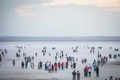 People walking on lake Tuz, Turkey. Royalty Free Stock Photo