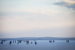 People walking on lake Tuz, Turkey. Royalty Free Stock Photography