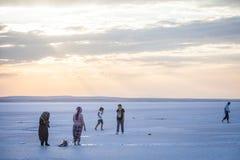 People walking on lake Tuz, Turkey. Royalty Free Stock Images